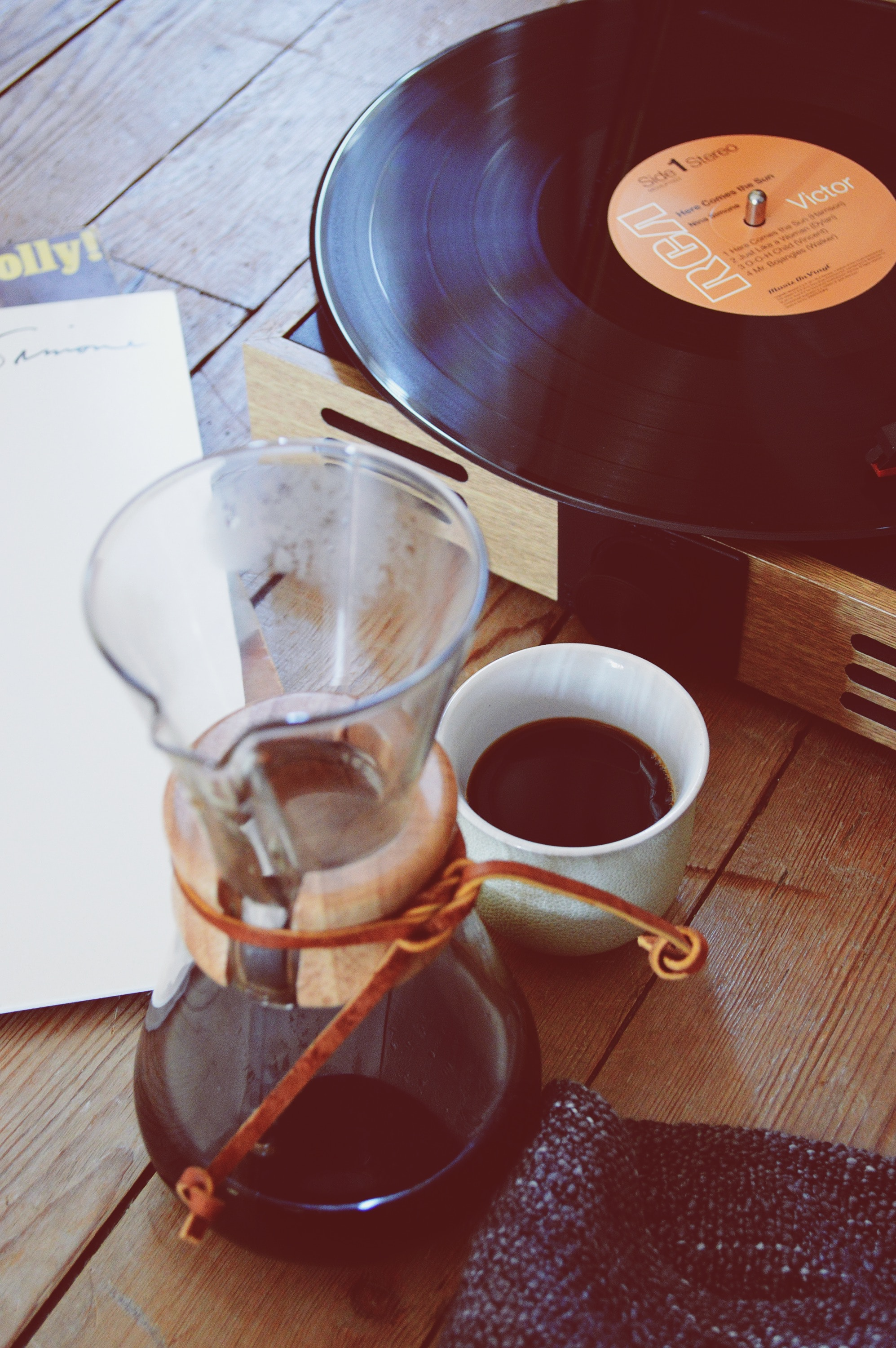image of a coffee mug and a record