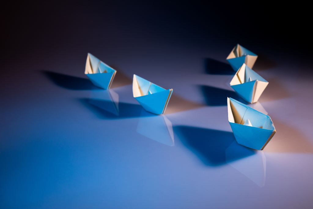 picture of paper boats. Example of mentors